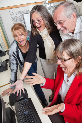 stock-photo-14531834-group-of-surprise-mature-adults-looking-at-computer